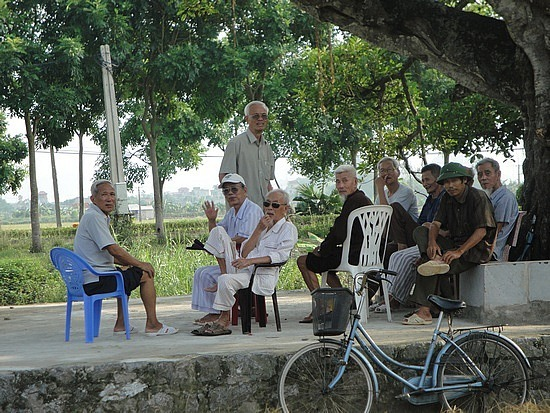 Local men under the meeting tree