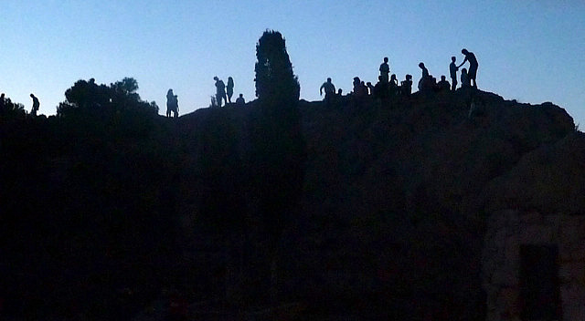 People silhouetted on Mars Hill
