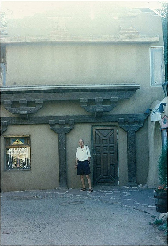 Dad outside an adobe building