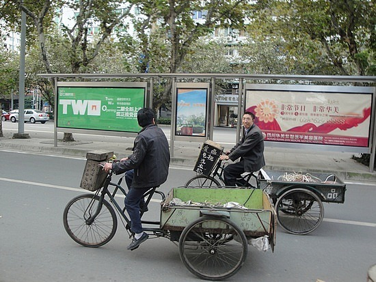 Trays behind bicycles are used for everything