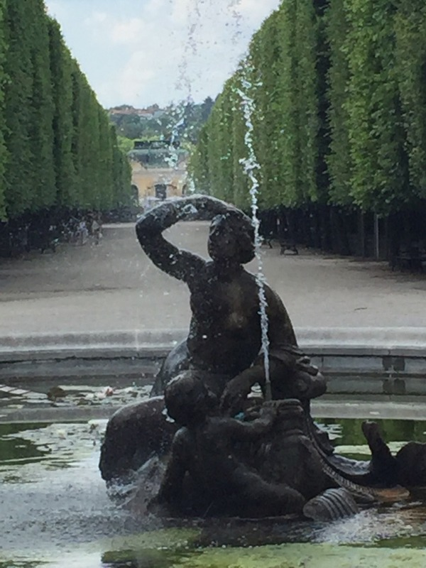 Fountain and high hedges