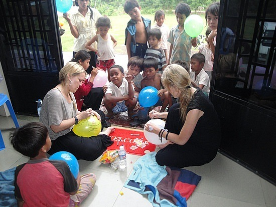 Cath & Beck playing with kids