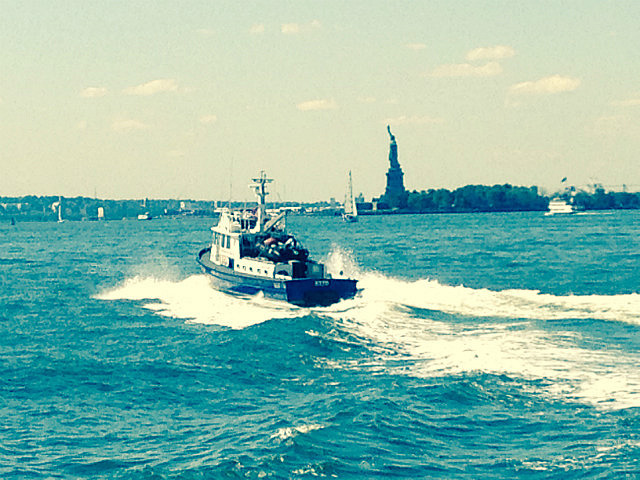 Statue of Liberty  behind the boat