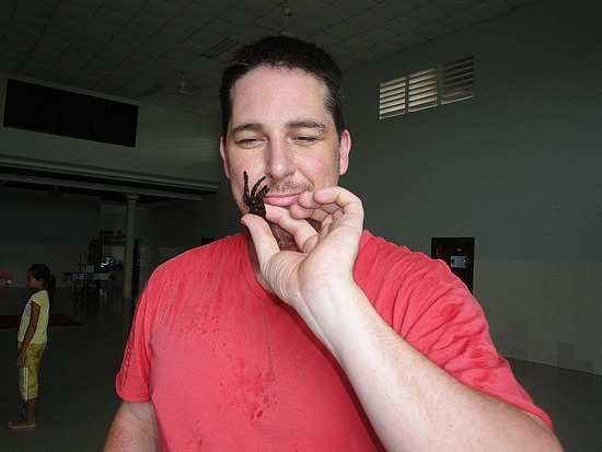 Jeremy eating a spider