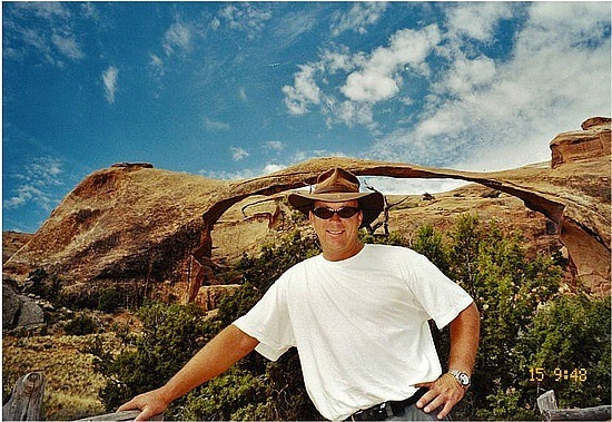 Brad in front of an arch
