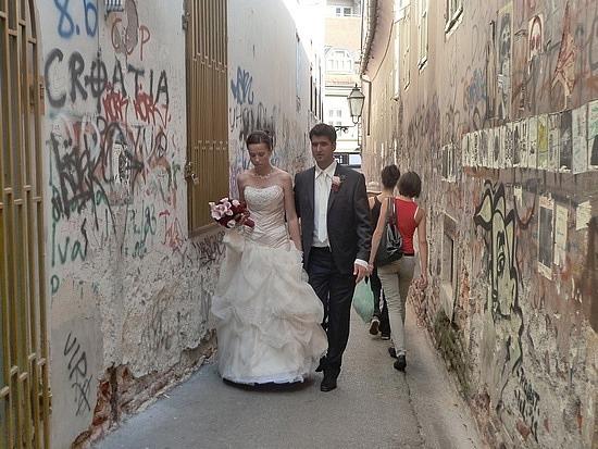 Bride and graffitti walls
