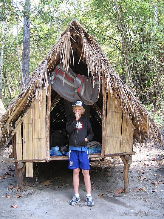 Nath outside our hut