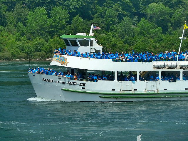 Blue poncho clad people on the Maid of the Mist