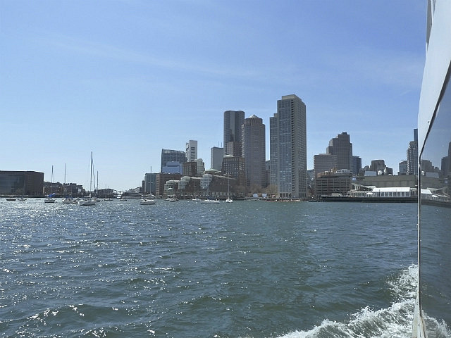 Ferry past city from Bunker Hill