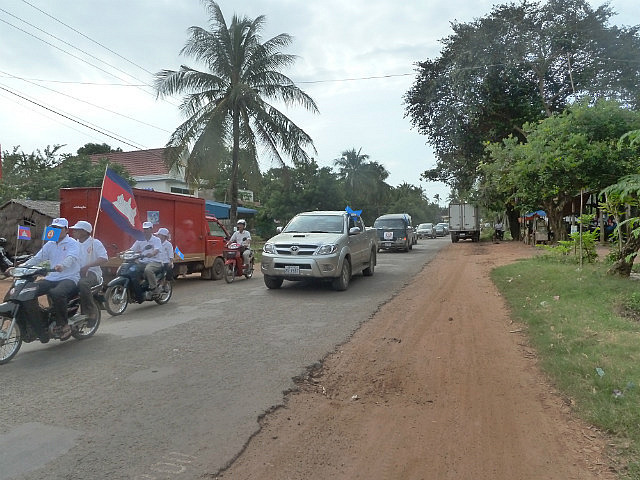 Busy road with political parties out in force