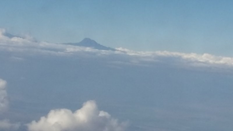 Not sure if this is Kilimanjaro? Leaving Tanzania...