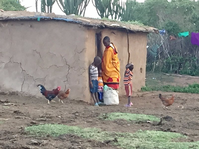 Maasai woman outside her home