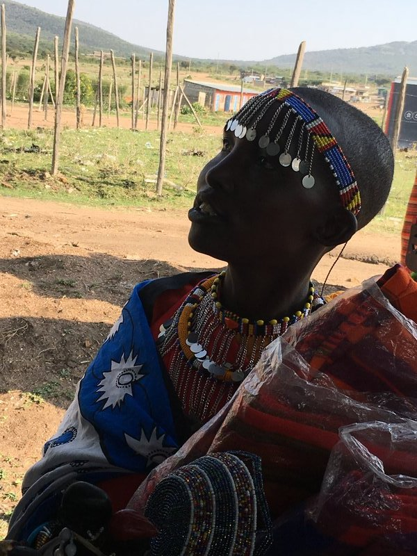 Beautiful Maasai women selling her crafts