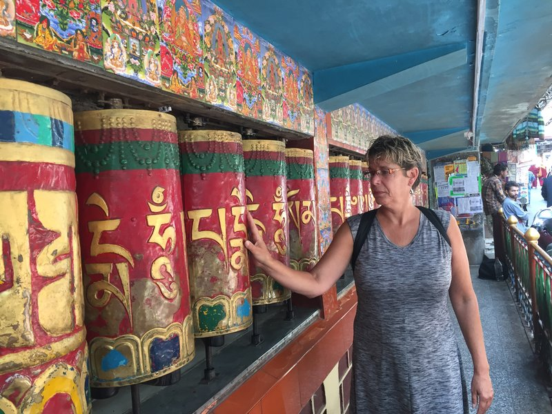 Shelley at temple prayer wheel in McLeod Ganj