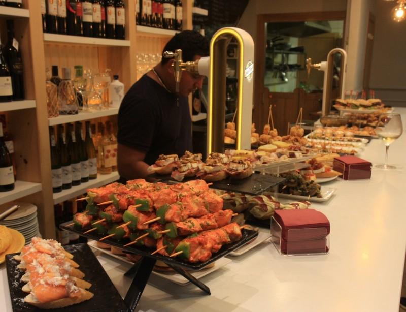 Pintxos lined up at a San Sebastian bar