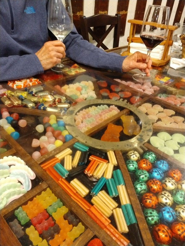 Our table at La Cepa restaurant - Old City, San Sebastian - lollies are sealed-in under a glass tabletop
