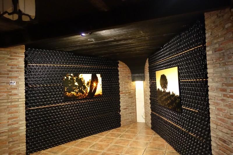 Wine maturing in cellars of Bodega (Cellar/Winery) Ontañón - Logroño (photos on backlit screens enhance the image of the cellar)