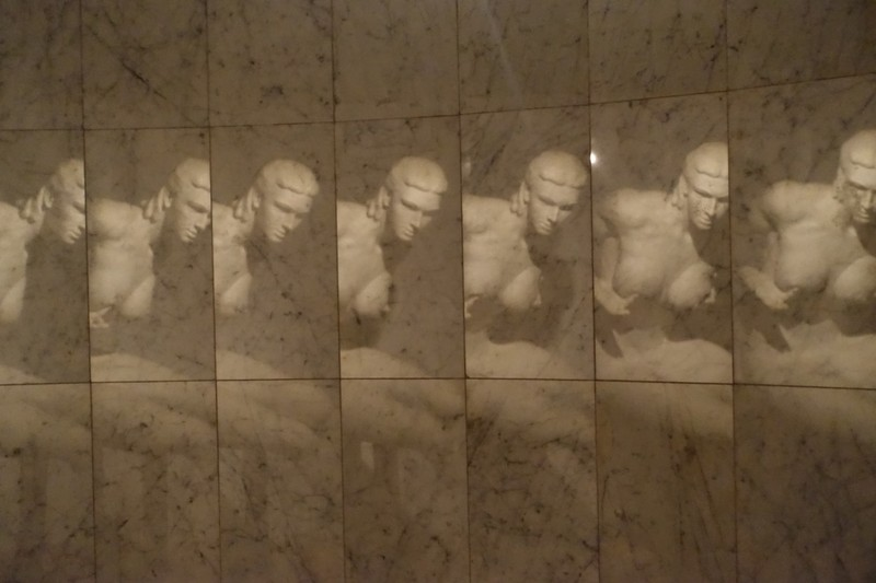 Reflection of statue of in marble tiles around the room - reflecting the coming and going of the seasons from spring through harvest