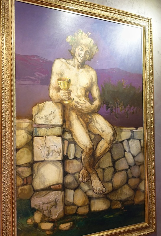Bodega Ontañón artwork - Dionysus looks happy - the 4 blocks beneath his right elbow show the effect of wine - Happy/singing; Feeling powerful; Somewhat lost; Acting like a jackass