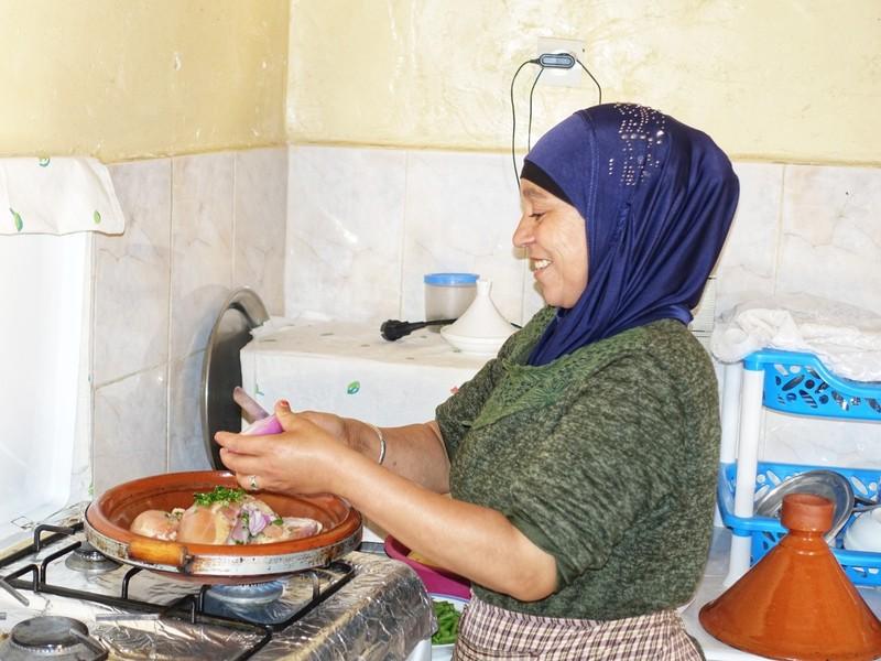 Fatima creating chicken tagine