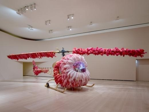 Lilicoptere - Joana Vasconcelos - Bell 47 helicopter, ostrich feathers, Swarovski crystals, gold leaf, industrial paint, dyed leather upholstery embossed with fine gold, Arraiolos rugs, walnut wood, woodgrain painting, and passementerie