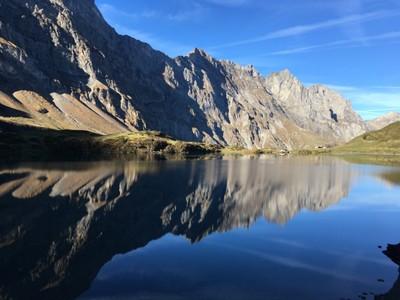 Still water on an alpine lake