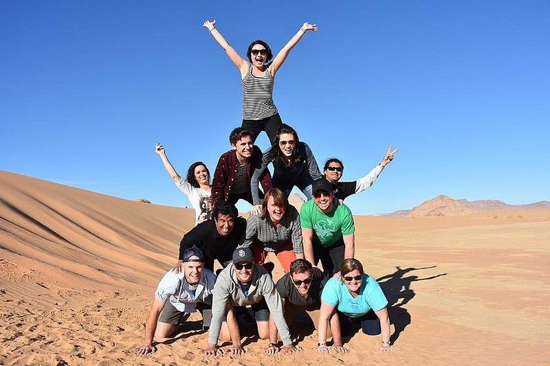 Flat tire in the desert - make human pyramid!