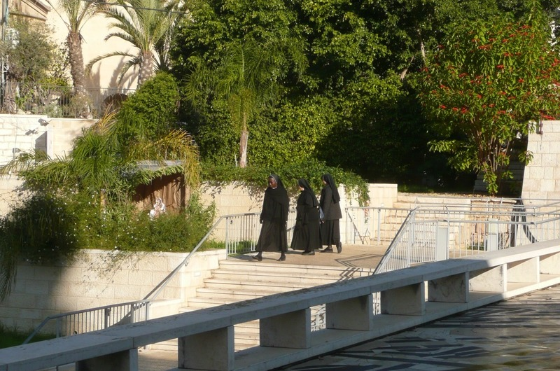 Nuns walking from one church to the other