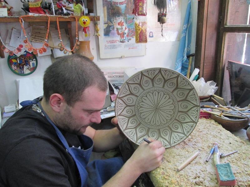 Demeter decorates a plate