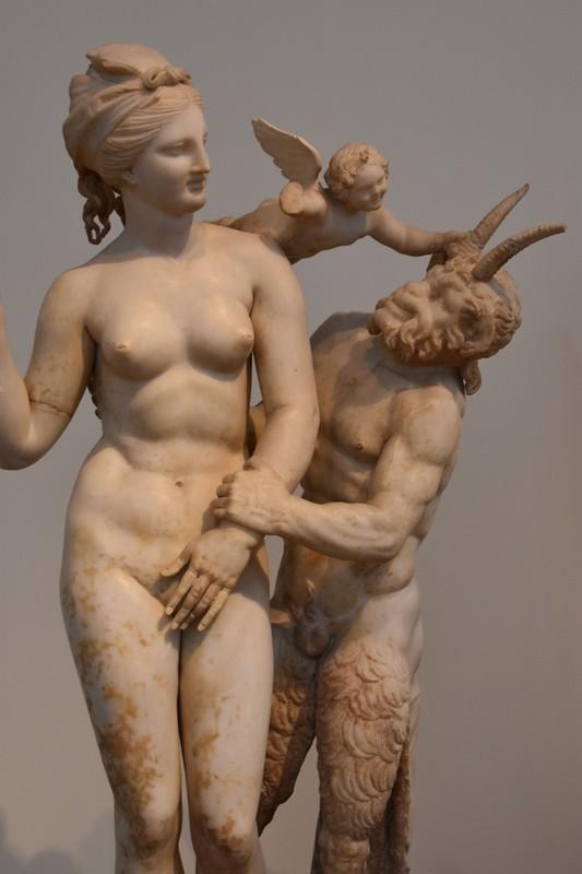 Aphrodite frolicking with Pan