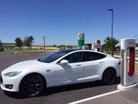A sign of the future - Tesla recharging at BP fuel station in France