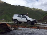 Truck Dares Pass over Rickety Bridge in Truso Valley
