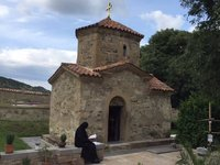 Nun Reading Outside Samtavro Church, Mtskheta