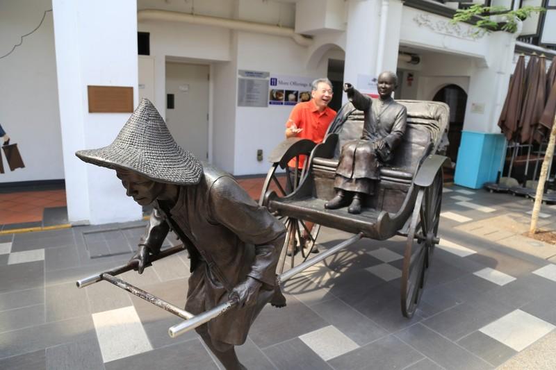"""""""Heading Home"""", bronze sculpture by Lim Leong Seng of a rickshaw puller"""
