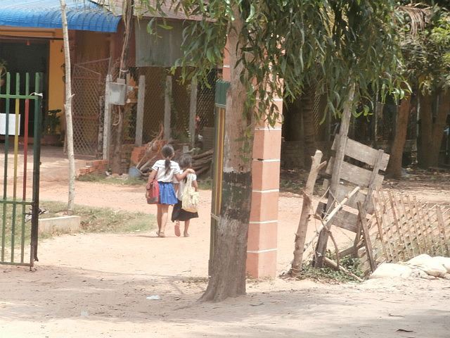 Two friends walking home from school