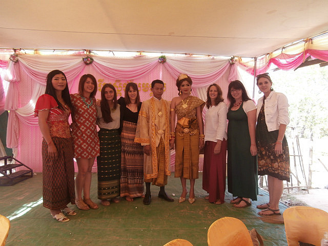 Wedding guests with bride & groom