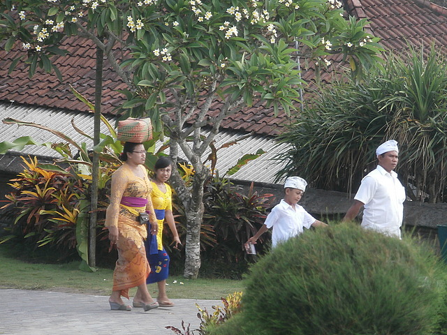 Family going to a temple ceremony