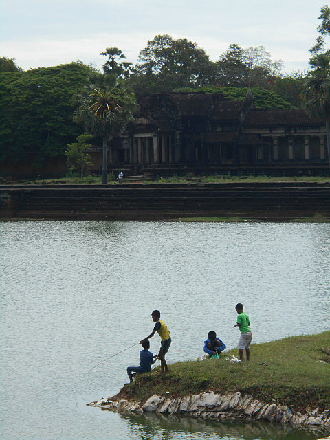 Boys fishing in the Angkor Wat Moat