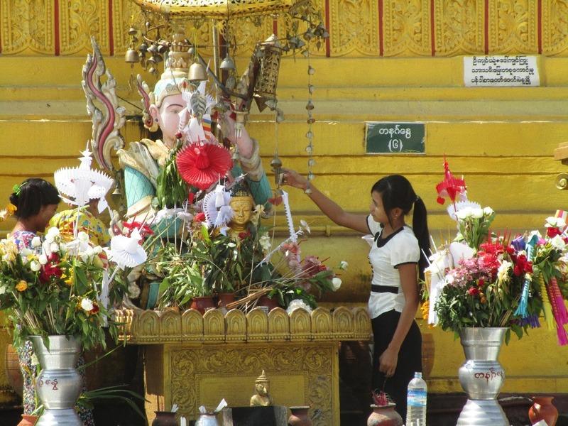 Washing buddha at the temple