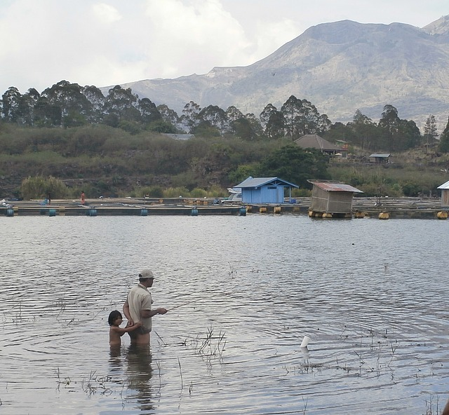 Fisherman & helper on Lake Batur