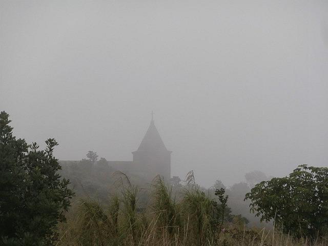Abandoned church in fog