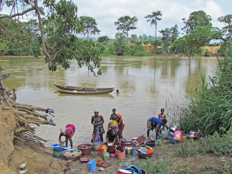 Villagers at the river, Man