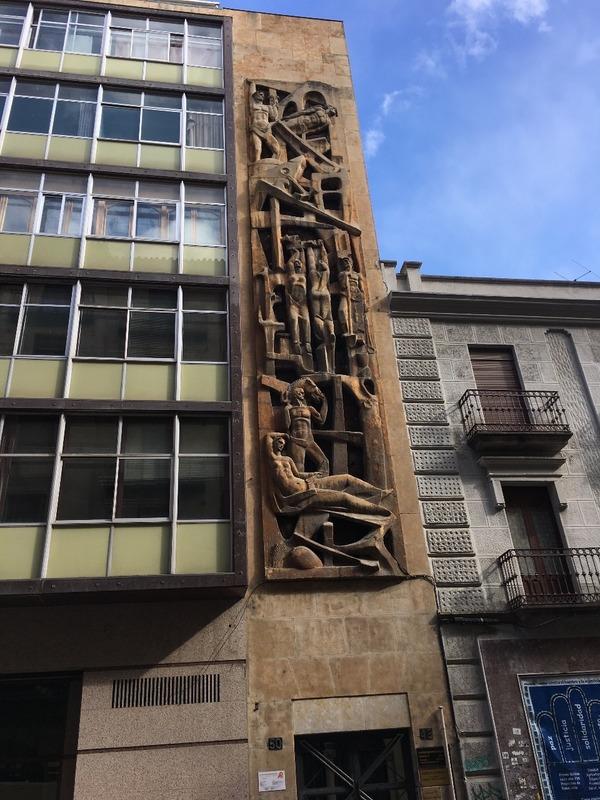 Handsome sandstone carving on ugly building