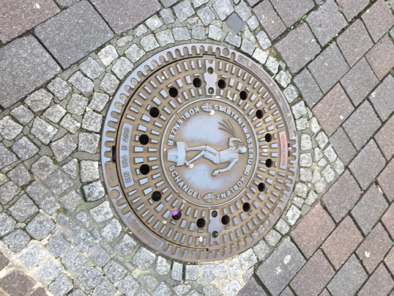 Manhole cover of spitting boy...