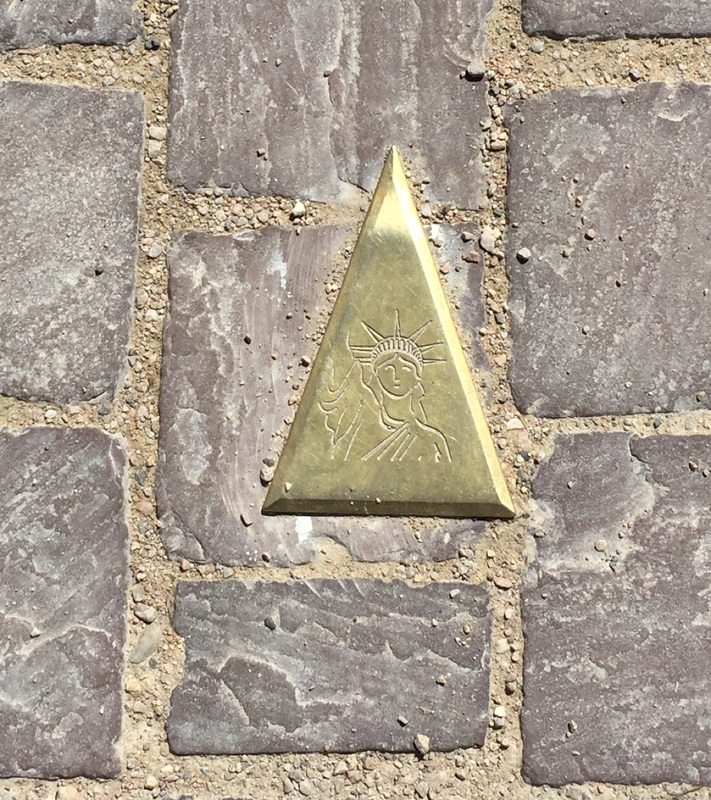 Tiny triangle leading to museum of Bartholdi