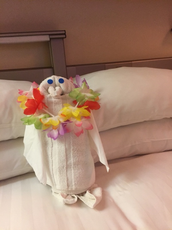 Our stewardess having fun with a towel.