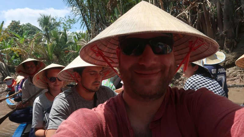 Canal tour in the Mekong Delta, Vietnam. The rice hats are an instant relief in the searing sunshine.