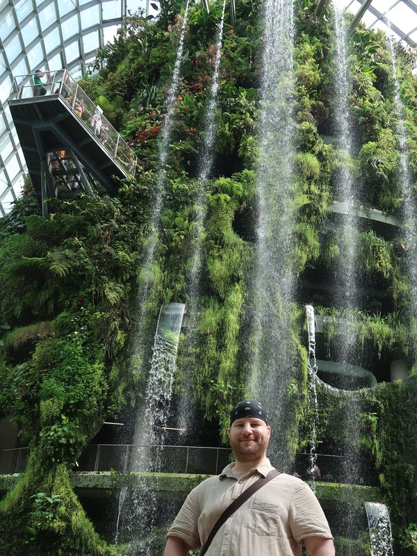 The in-door waterfall catches the visitor's eye directly at the entrance of Cloud Forest, Gardens by The Bay, Singapore.