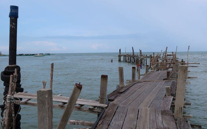 Half decayed pier at Penang National Park, Malaysia.