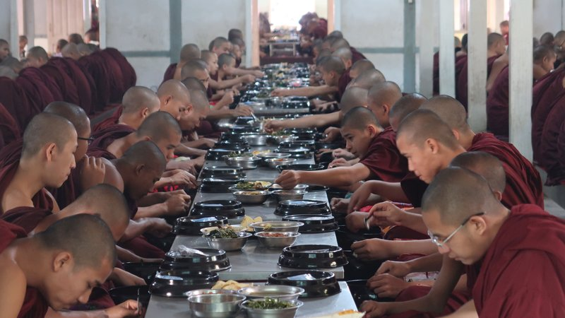 A glance through the open windows of the breakfast area of a monastery in Mandalay, Myanmar.